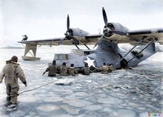 US Navy personnel freeing a PBY-5A 'Catalina' aircraft from frozen waters in the Aleutian Islands at Kodiak Bay, US Territory of Alaska