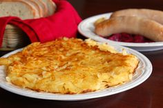 Roesti is the Swiss version of potato hash browns/potato pancakes made with butter, potatoes, and salt. Roesti is a national dish of Switzerland.