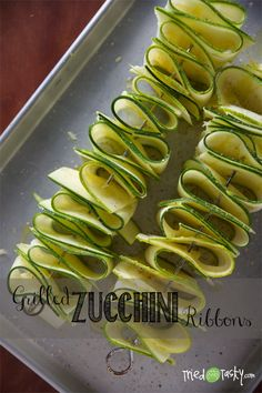 Grilled Zucchini Ribbons. This looks so pretty. It'd be perfect for summer barbecues.