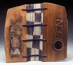 Bookbinding - Open Book by Karen Kunc.   1992  bookwork: acrylic & graphite on walnut wood, foil lettering, sewn binding  12 x 5 x 5""