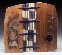"Bookbinding - Open Book by Karen Kunc.   1992  bookwork: acrylic & graphite on walnut wood, foil lettering, sewn binding  12 x 5 x 5"""