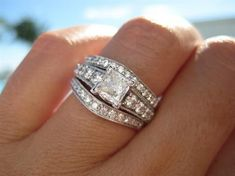 This is very similar to what my engagement ring and bands will look like. My engagement ring is just off center so the center diamond looks like a diamond.