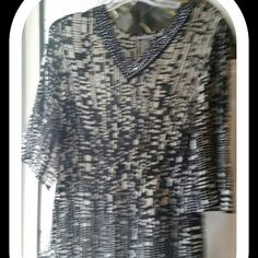 NWT. BLACK & CREAM BLOUSE NWT BLACK & CREAM GATHERED DESIGNED PLEATED FLAIR AT THE BOTTOM, SAME DESIGN ON BOTTOM OF SLEEVE.  DESIGNED STUDS AROUND THE NECK. LIGHT & BREEZY. .SO COMFY. WASHABLE . Catherines  Tops Blouses