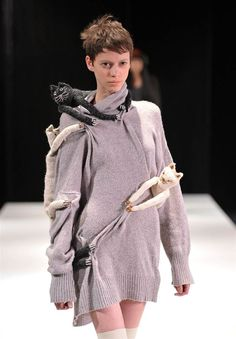 A cat lady walks the runway at the Miguel Adrover Fall 2012 fashion show on Feb. 11.