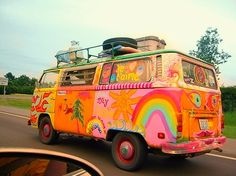 painted van- pink and greenish and orange and yellow and rainbow and tree and sun