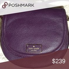 """♠️kate spade Oliver Street Lilly Crossbody Saddle This is the perfect fall bag!! The color is a gorgeous deep purple, """"soft aubergine"""". Brand new with tags. Pebbled leather bag has front flap with magnetic closure; Gold-toned hardware Adjustable shoulder strap with maximum drop of approx. 23 inches Front has embossed Kate Spade name plate Fabric lined interior features front full length slip pocket; Main compartment has 1 slip pocket Approx. dimensions: 8.25 inches (L) x 7.25 inches (H) x…"""