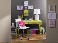 This eclectic home office shows its style with color. The chartreuse desk, white chair and floral canvas art ground the room against the more muted taupe and gray walls. The result is an organized space with lots of design flair Dorm Room Designs, Interior Decorating, Interior Design, Interior Paint, Decorating Ideas, Home Office, Room Decor, Dining, Gray Walls