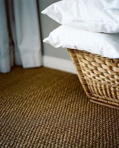 Natural Fiber Carpet - A basket of pillows atop natural-fiber carpeting