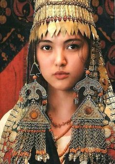 Beautiful woman; her jewelry, especially large earrings bring attention to her face. Kyrgyzstan