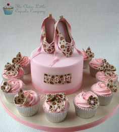 Ballet Shoes Christening Cake - Gumpaste hand crafted ballet shoes, with hand painted leopard skin.  Matching cupcakes.