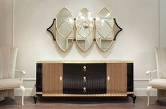 Contemporary style sideboard DUKE from Italian manufacturer BRUNO ZAMPA. Black high gloss lacquer, front doors in natural Canaleto Noce veneer. Hanging mirror with hand carved framed, custom chosen fabric back. More interior solutions: www.baldainamams.lt