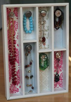 Oooh I so have to do this!  My necklaces are currently hanging on a hanger on my closet doorknob!