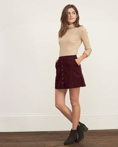 Womens Faux Suede A-Line Skirt | Add texture to your outfit with supersoft corduroy fabric in an A-line silhouette, finished with full button closure at front, Classic Fit | Abercrombie.com