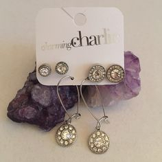 Earring set Silver set of 3 pairs of earrings. Never been worn. Received as a gift, however it is not my style.                                                                           BUNDLE JEWELRY FOR A BETTER DEAL Charming Charlie Jewelry Earrings