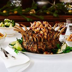 This elegant pork crown roast makes a perfect centerpiece for Christmas. The sweetness of the pear stuffing is a great complementary flavor that your guests are sure to enjoy. Stuffing Recipes, Pork Recipes, Cooking Recipes, Diet Recipes, Recipies, Thanksgiving Recipes, Holiday Recipes, Christmas Recipes, Recipes