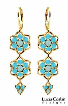 Lucia Costin Flower Shaped Dangle Earrings Made of 14K Yellow Gold Plated over .925 Sterling Silver with Mint Blue, Turquoise Swarovski Crystal Flowers, Twisted Lines and Lovely Charms; Handmade in USA Lucia Costin. $79.00. Splendid combination of dangle elements. Mesmerizing enough to wear on special occasions, but durable enough to be worn daily. Beautifully crafted with blue opal and turquoise Swarovski crystals. Dangle earrings beautifully designed by Lucia Costin. Unique jew...