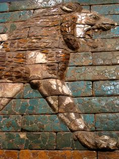 Detail of a striding lion made from polychrome glazed bricks, one of dozens that decorated the walls of the Processional Street and the royal palaces of Babylon. The relief dates back to the era of king Nebuchadnezzar II of Babylon (605-562 BCE). The Metropolitan Museum of Art, New York City, NY.