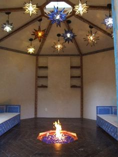 This eco octagonal yurt  is made of all recycled materials. It has a fire pit in the floor, that even after being covered up continues to radiate heat. The skylight in the ceiling directly above the fire pit opens for safety.  The custom made Moroccan love seats slide together to form a bed.  This structure functions as a guest house and meditation room. Only $4000! http://newmanbuildingdesigns.com/yurts/topangayurt.html