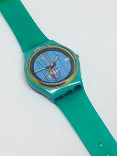 Vintage Swatch Watch 1987 Vintage Swatch Watch from 1987 is running and keeping perfect time and date with an included battery. Brand new unworn bands. Step On A Lego, Vintage Swatch Watch, Aqua, Turquoise, Fashion Watches, Summer Collection, Jelly, Bracelet Watch, Two By Two