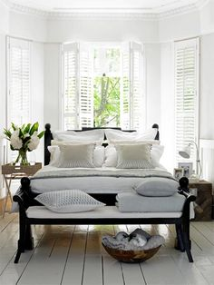 With its crisp, neutral linens and plethora of plush pillows, this charming bedroom beckons you to curl up with a good book, or take a leisurely nap following afternoon tea. Here are a few fabulous finds to get this fresh and inviting look in your bedroom now.