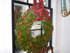 A lovely wreath hung by tartan ribbon hangs in the Sherman home during the Kappa Homes Tour. #KKG #KKG1870