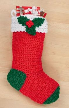 "Crochet Holly Stocking-  RHSS - Traditional: 1 Oz White CA, 5 oz Hot Red CB, 1 oz Paddy Green CC. OR Victorian: 1 Oz Aran CA, 5 oz Burgundy CB, 1 oz Hunter CC. Crochet Hooks: K/10.5/6.5 mm, 4/G/6mm  Size: Stocking measures 19-1/2"" long. free pdf from Red Heart, does not contain pic"