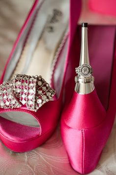 I love the silver heel and the creative way the photographer used it to display the engagement ring and wedding band!  #pink #color #colours