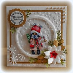 Card made by DT member Jolanda with among others Design Folders Dutch Dots (DF3402), Collectables Snow Globe (COL1362) and Creatables Poinsettia (LR0121) by Marianne Design