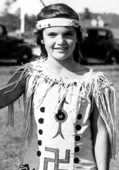 Jackie in dress up with a swastika, it was a girl scout uniform