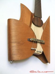 Now, that's different! Leaf Guitar by Ezequiel Galasso, via Behance.