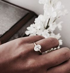 elegant minimal engagement ring, oval diamond