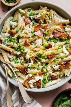 Pasta With Peas Pancetta and Goat Cheese by The Modern Proper. Speckled with emerald-green sweet peas and crisp savory nuggets of pancetta this creamy penne pasta with peas pancetta and goat cheese is springtime in a bowl. Goat Cheese Pasta, Goat Cheese Recipes, Top Recipes, Cooking Recipes, Beef Recipes, Pizza Recipes, Italian Food Recipes, Authentic Italian Recipes, Easy Recipes