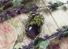 Amethyst Hand Sculpted Leaf and Wire Vine Swirled Pendant Necklace, Fairy, Faery Garden, Fae, Metaphysical Jewelry by TheeEnchantedChest on Etsy https://www.etsy.com/listing/492215525/amethyst-hand-sculpted-leaf-and-wire