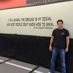 """We have a BJJ shirt that we released recently that says """"The ground is my ocean, Im the shark"""". Online the credit is mostly given to Carlos Machado. But I'm lucky enough to have a legend like Jean Jacques Machado as an instructor, so I asked him today who was the first to say this quote! His answer was that he in fact was the first, but his quote was slightly different than his brother Carlos Machado's."""