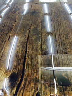 Such a beauty! Tabletop out of old wood, finished with liquid gloss