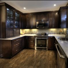 Cherry cabinets with a mocha finish, Kashmir White granite, and Ulvio wood-look tile.