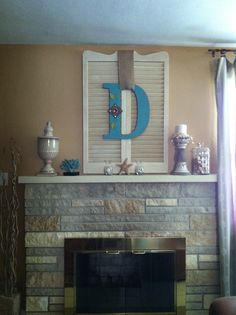 """Fire place mantel display. Family last name initial, bought at """"Hobby Lobby!"""" Repurposed shutters were a roadside acquisition!!!"""