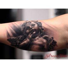 Cherub Tattoo by Silvano Fiato, Italian Tattoo Artist
