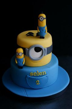 Tiered minion cake by Sugarplum Cake Shop