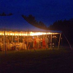 Our guests enjoying dessert and dancing under the tent at the Swiss Ski Lodge