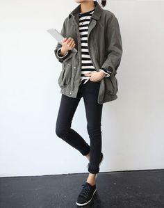 Black sneakers, rolled skinny jeans,