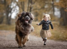 Photographer Andy Seliverstoff captures the relationship between little kids and their big dogs.