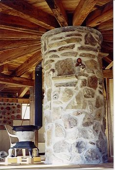cord wood homes | Cordwood Home Construction middle support beam, for the roof.