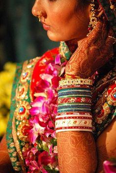 Beautiful ornamental bangles, saree and mehndi.