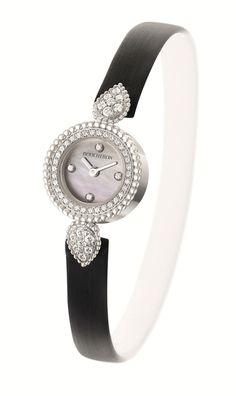 La montre Serpent Bohème de Boucheron. Boîtier en or blanc, serti de diamants. Cadran en nacre et bracelet en satin noir. http://www.vogue.fr/joaillerie/le-bijou-du-jour/diaporama/le-bracelet-serpent-bohme-haute-joaillerie-de-boucheron/18789/carrousel#la-montre-serpent-bohme-de-boucheron-botier-en-or-blanc-serti-de-diamants-cadran-en-nacre-et-bracelet-en-satin-noir