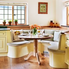 kitchen tables with bench seating | CUrved banquette seating with round table in corner of kitchen ...