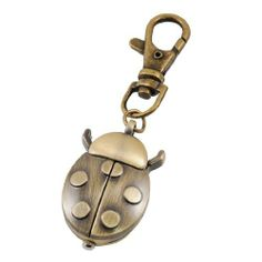 """Como Bronze Tone Metal Ladybird Shape Pendant Key Ring Watch by Como. $5.99. Product Name : Key Ring Watch;Material : Metal. Weight : 30g. Package Content : 1 x Key Ring Watch. Color : Bronze Tone;Pendant Size : 3.3 x 2.4 x 1cm/ 1.3"""" x 0.9"""" x 0.4""""(L*W*H). Total Length : 8cm/ 3.1"""". The Watch features ladybird shape pendant, hunter case, adjust time by this knob. Mini key ring with lobster clasp design, convenient to carry."""