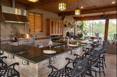 Wrought iron corbels on cultured stone island benches, barbie with rangehood, a great luxed up entertainment area.