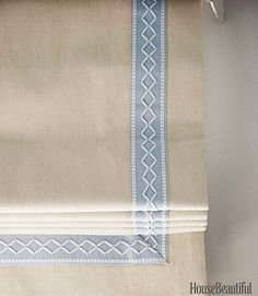 Roman shade details - white roman blind with blue embroidered tape trim by Lee Ann Thornton - House Beautiful via Atticmag