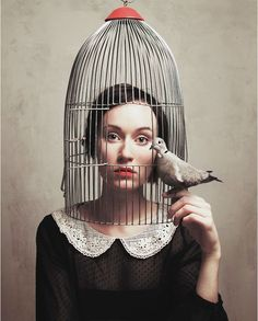 Previous pinner: 'This woman has the option of freedom but chooses to be caged, to take (the) place of the bird. As free as the bird is, it stays with the woman.' | Surreal self-portrait photography By Flora Borsi | InspireFirst ↬